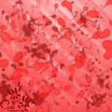 Red and burgundy background with stains and paint splashes with small flowers in the corner Stock Images