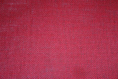 Red burlap background stock photo