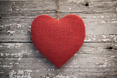 Red burlap heart on vintage table Stock Images