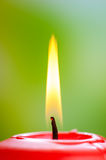 Red burning candle Stock Images