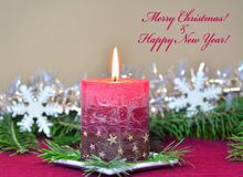 Red burning candle with Christmas decorations, fir branches Royalty Free Stock Image