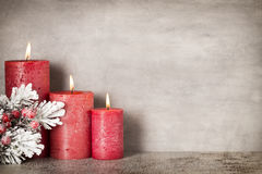 Red burning candle on a gray background. Interior items. Royalty Free Stock Image