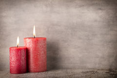 Red burning candle on a gray background. Interior items. Royalty Free Stock Photo