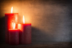 Red burning candle on a gray background. Interior items. Royalty Free Stock Images