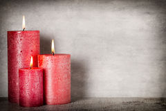 Red burning candle on a gray background. Interior items. Royalty Free Stock Photos