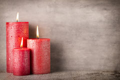 Red burning candle on a gray background. Interior items. Stock Image