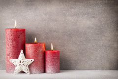 Red burning candle on a snow background. Interior items. Red burning candle on a snow background. Interior items royalty free stock photography