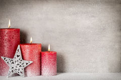 Red burning candle on a snow background. Interior items. Royalty Free Stock Photos