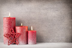 Red burning candle on a snow background. Interior items. Royalty Free Stock Photography