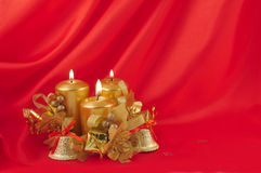Red burning candles bell Stock Images