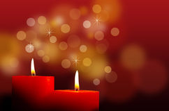 Red burning candles. Burning red candles with bokeh Royalty Free Stock Images