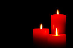Red burning candles for Christmas. Black background Royalty Free Stock Photography