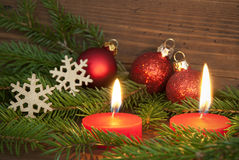 Red Burning Candles with Christmas Decoration Stock Image