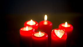 Red burning candles. In night royalty free stock photos