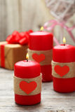 Red burning  candles over the wood background. Valentine Stock Photography