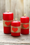 Red burning  candles over wood background. Valentine Royalty Free Stock Photography