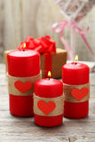 Red burning  candles over wood background. Valentine, close up Royalty Free Stock Photo