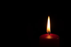 Red Burning Christmas Candle Royalty Free Stock Images