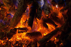 Red burning hot coals in stove Stock Photo