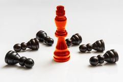Red burning King and many fallen pawns - chess concept Royalty Free Stock Photos