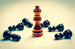Red burning Queen and many fallen pawns - chess concept Royalty Free Stock Photos