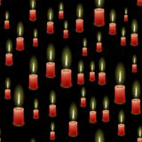 Red Burning Wax Candles Seamless Pattern. Isolated on Black Background Royalty Free Stock Photography