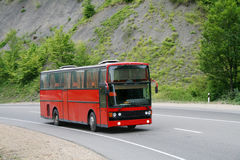 Red bus. The red bus in mountainous country Stock Photo