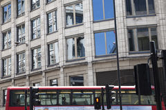Red Bus And Windows From Offices In UK Royalty Free Stock Image