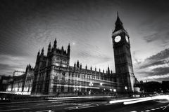 Red bus, Big Ben and Westminster Palace in London, the UK. at night. Black and white Stock Image