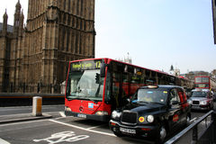 Red bus and cab outside Houses of Parliament, London, UK Stock Photos