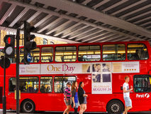 Red bus at the Camden Lock Bridge. Stock Image