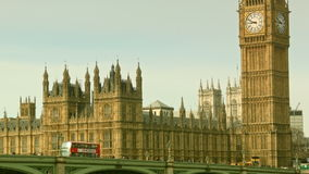 Red bus crosses the bridge, Big Ben, close up stock footage