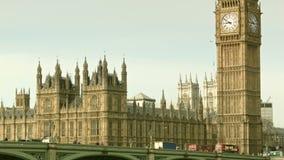 Red bus crosses the Westminster Bridge, Big Ben. Classic view of the Big Ben and Westminster in London stock video
