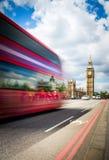 Red Bus crossing Westminster Bridge Stock Images