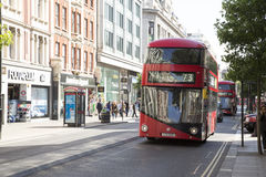 Red bus driving along Oxford street Stock Photos