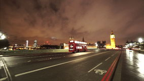 Red Bus driving over Westminster Bridge London. LONDON, ENGLAND stock video