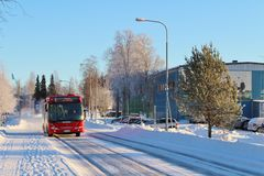 A red bus. Driving on a winter road Stock Images