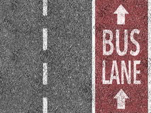 Red bus lane on asphalt Royalty Free Stock Photography