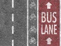Red bus lane on asphalt. Red bus lane marked on asphalt Royalty Free Stock Image