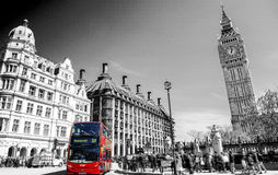 Red bus in Lodon street view with Big Ben in panorama , black and white.  Royalty Free Stock Photo