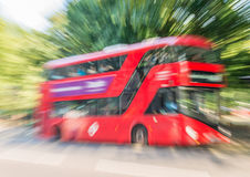 Red Bus in London, fast moving blurred view Royalty Free Stock Photo