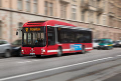 Red bus with motion blur. Stock Photos