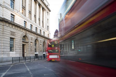 Red Bus in motion in City of London Royalty Free Stock Images