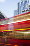 Red Bus in motion in City of London Stock Images