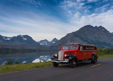 Red Bus Passes at St Mary Lake Stock Image