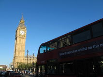 Red Bus Passing in front of Big Ben stock images