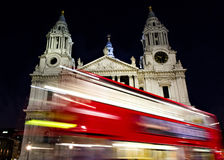 Red bus passing St- Paul's cathedral Stock Photo