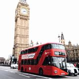 Red Bus on Road Near Big Ben in London Stock Images