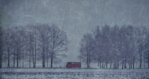 Red bus in a snowy field Stock Photos
