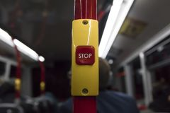 Red bus stop button. On a double decker bus with the word STOP written in white Royalty Free Stock Photo